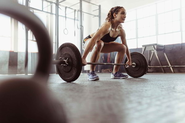 Grip strength gym woman lifting weights